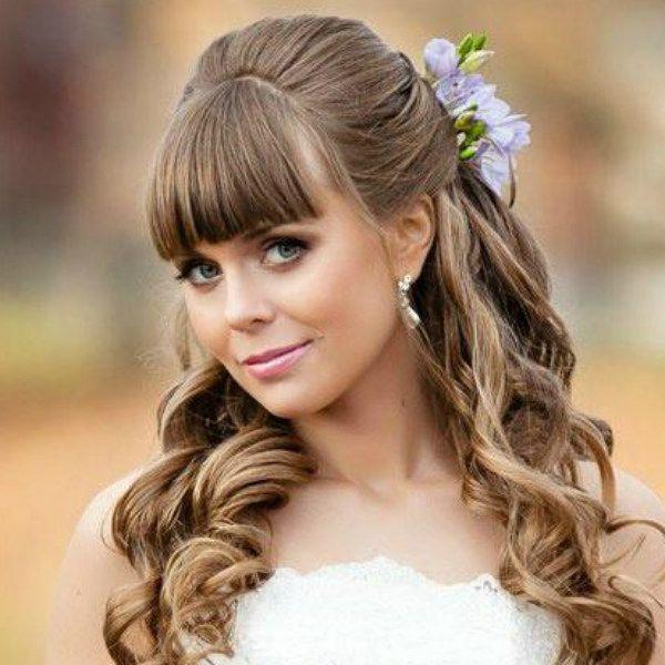 Зачіска з квітами фото
